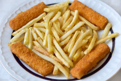 Fish and chips. Fish fingers and chips on the plate. Selective focus royalty free stock photo