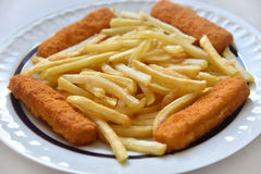 Fish and chips. Fish fingers and chips on the plate. Selective focus stock photography