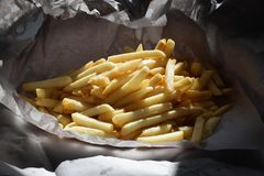 Delicious Fresh Fish and Chips Wrapped in Paper royalty free stock photo