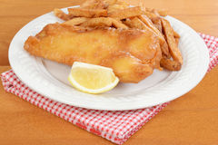Fish and chips with lemon Royalty Free Stock Photo
