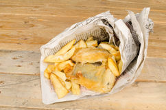 Fish and chips in newspaper Stock Photos
