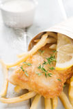 Fish and chips in paper cone Stock Photography