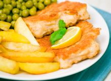 Fish and chips with peas Royalty Free Stock Photo