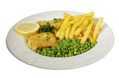 Fish ,chips and peas garnished with lemon and pars Royalty Free Stock Photos