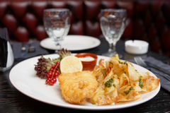 Fish and chips in plate Royalty Free Stock Photo