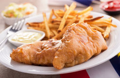 Fish and Chips. A plate of delicious fish and chips with tartar sauce and coleslaw Stock Photos