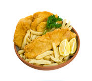 Fish, Chips and Potato Cakes over white background. Fish, chips and potato cakes isolated over white background Royalty Free Stock Images