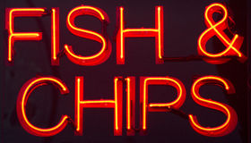 Fish and chips restaurant neon sign Royalty Free Stock Image