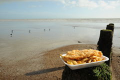 Fish and Chips By the sea. Fish and Chips Photographed at the seaside with sea behind Royalty Free Stock Photography