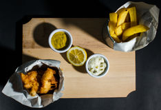 Fish and chips. Served with mayo souce royalty free stock photography