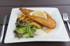 Fish and Chips Served on Square Plate Stock Image