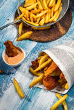 Fish & Chips served traditionally in the newspaper Royalty Free Stock Image