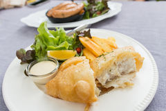 Fish and chips served on a white plate Stock Photos