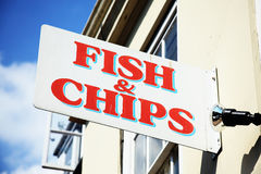 Fish and chips sign. UK fish and chips sign advertising the traditional English take away meal Royalty Free Stock Images