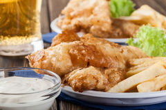 Fish and chips with tartar sauce on a plate Royalty Free Stock Images