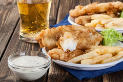 Fish and chips with tartar sauce on a plate Royalty Free Stock Photo