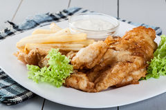 Fish and chips with tartar sauce on a plate Royalty Free Stock Photography