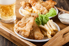 Fish and chips with tartar sauce on a tray Stock Images
