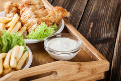 Fish and chips with tartar sauce on a tray Royalty Free Stock Photography