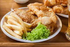 Fish and chips with tartar sauce on a tray Stock Photography
