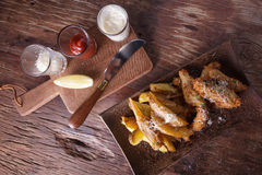 Fish and chips with tartar sauce Stock Images