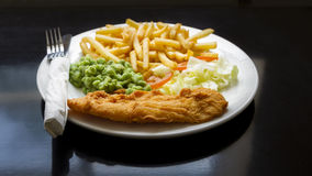 Fish & Chips. Traditional British Fish and Chips with mushy peas Royalty Free Stock Photo