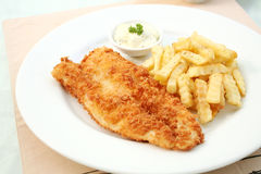 Fish and chips on white plate Stock Photography