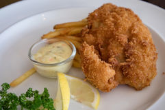 Fish and chips on white plate Royalty Free Stock Images