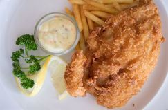Fish and chips on white plate Stock Images
