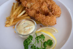 Fish and chips on white plate Royalty Free Stock Photo