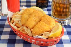 Fish and chips wrapped in newspaper Royalty Free Stock Image