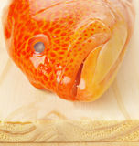Fish of chopping board. Close up of fish on chopping board Royalty Free Stock Image