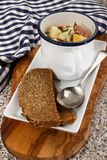 Fish chowder in a mug with bread on a plate Stock Photos