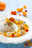Fish in citrus sauce with rice. Stock Images