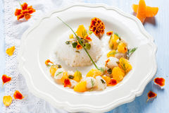Fish in citrus sauce with rice. Stock Photography