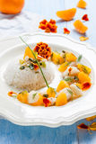 Fish in citrus sauce with rice. Royalty Free Stock Photo