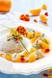 Fish in citrus sauce with rice. stock photo