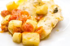 Fish cooked in a pot, cod with red tomato and potatoes Stock Photo
