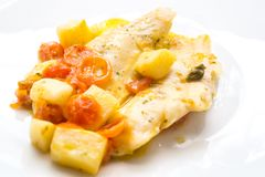 Fish cooked in a pot, cod with red tomato and potatoes Royalty Free Stock Photography