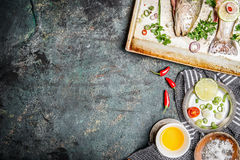 Fish cooking background with ingredients, top view.  Healthy food or diet concept. Stock Images