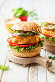 Fish and crab burgers Stock Photos
