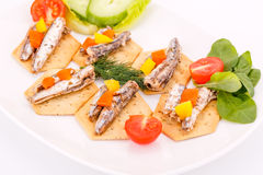 Fish on crackers Stock Images