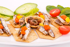 Fish on crackers Royalty Free Stock Photos