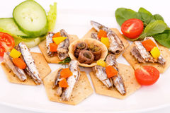 Fish on crackers Royalty Free Stock Photo
