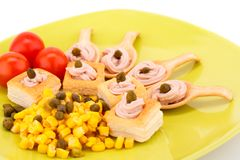 Fish cream in pastries. Sweet corn and capers on green plate Royalty Free Stock Image