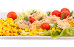 Fish cream in pastries. Sweet corn, cherry tomato and lettuce on white plate Royalty Free Stock Photos