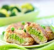 Fish croquette with green pea Royalty Free Stock Photography
