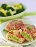Fish croquette with green pea. On green plate Stock Photos