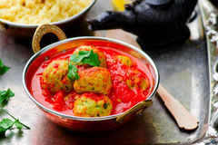 Fish croquette in tomato sauce in a copper bowl. On a metal background. Moroccan cuisine. style vintage. selective focus Royalty Free Stock Photo