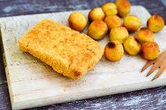Fish and Croquette. On a wooden  plate Royalty Free Stock Photography